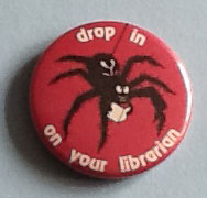 Picture of badge showing spider