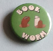 Picture of badge with a bookworm